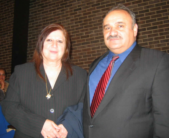 Mrs. Dadeh and Dr. Adam Benjamin standing before the Chaldo-Assyrian Community Center in Skokie, IL.